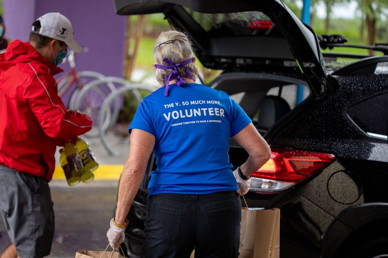 Volunteers Loading Cars at Food Distribution Event at Oviedo YMCA