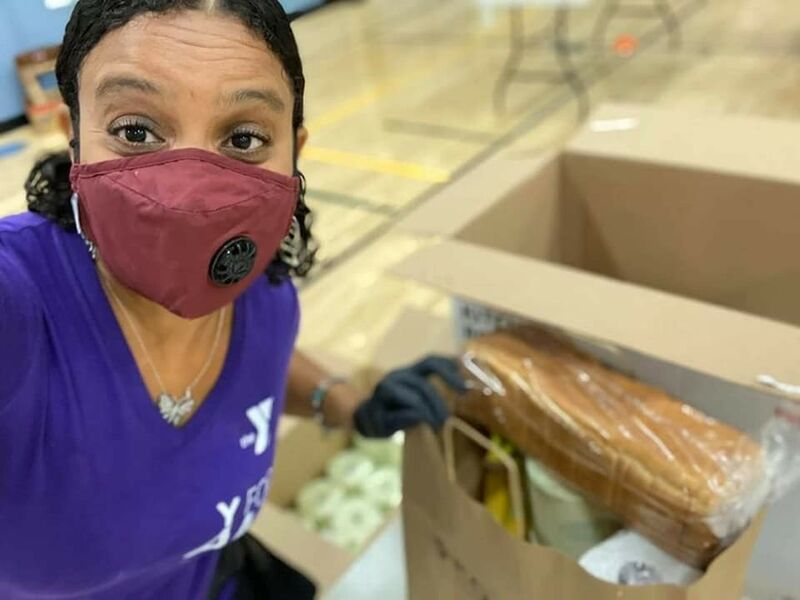 Volunteer Packing Supplies at Food Distribution Event at Titusville YMCA