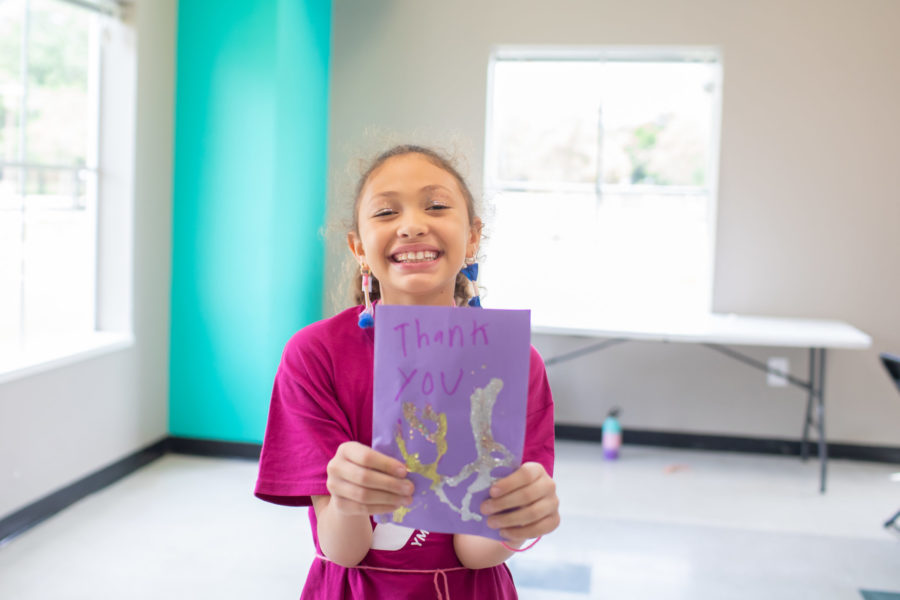 Child Holding up a Thank You Card